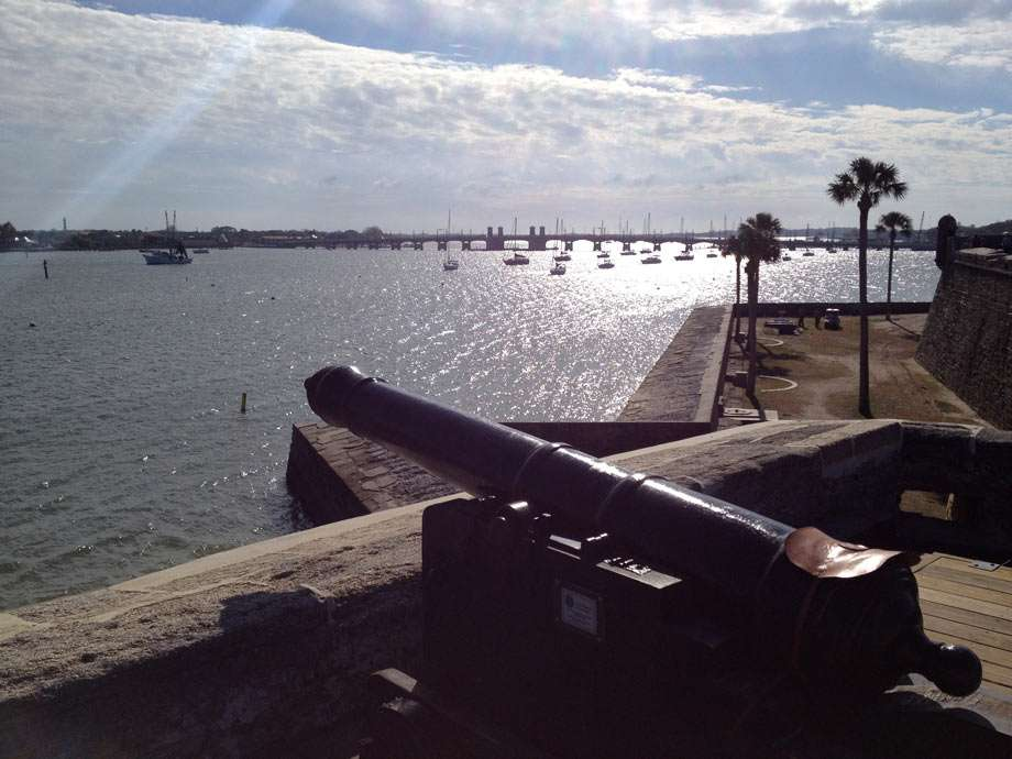cannons rest on stone walls overlooking the water