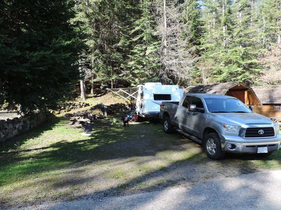 a truck and a travel trailer parked at a campsite while workamping