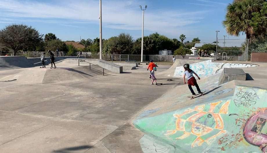 kids skateboarding at a skatepark