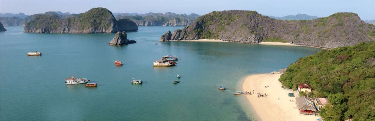 a small village and many boats in the plethora of island near cat ba island, vietnam