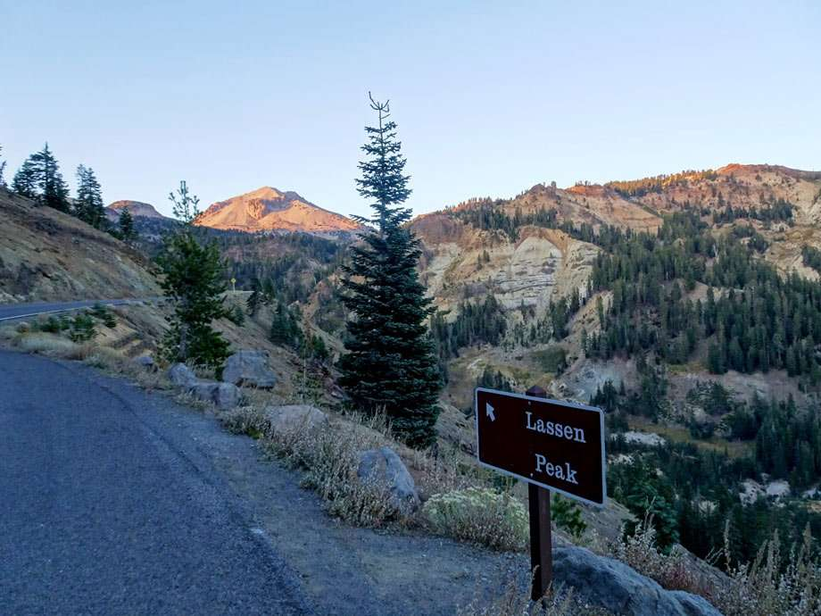 a sign points the way to lassen peak