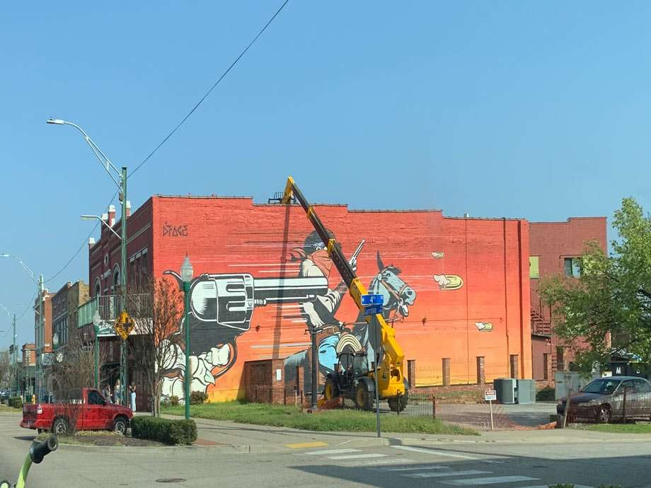 a mural of a 6 shooter in Fort Smith, Arkansas