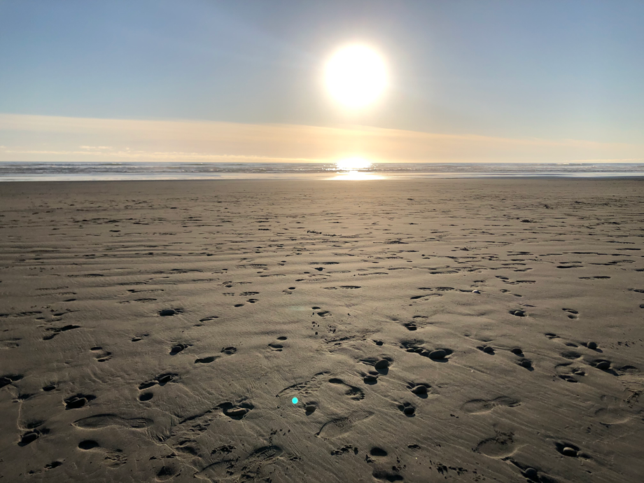 footprints in the sand, and a sunset. it is unclear whether Jesus made them both or not.