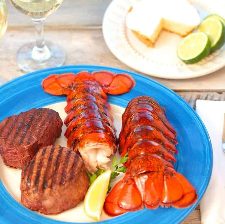 lobster and steak, cooked on a campfire