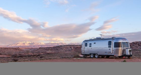 an airstream travel trailer parked in the desert