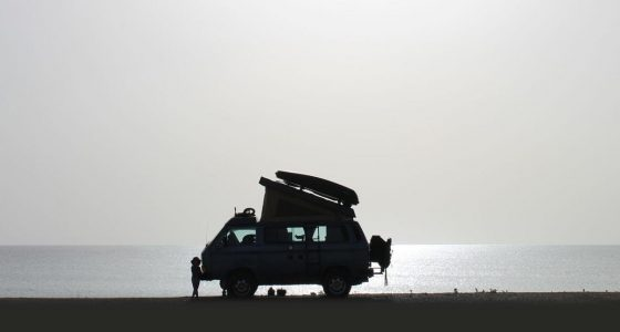 a 1987 Vanagon Syncro Westfalia parked on a beach
