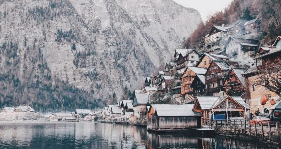 beautiful town on a hillside, near a pristine lake and a stunning mountain