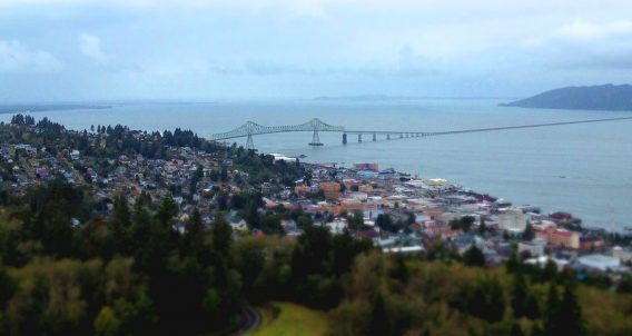 Astoria, Oregon hangs from the hills of the Columbia River over the Pacific Ocean