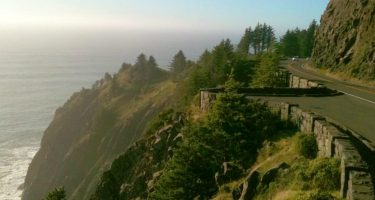 US 101 hangs like a castle from the cliffs of Neah-Kah-Nie Mountain, the Pacific Ocean below it all