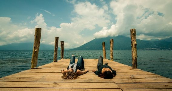 two women resting on a dock
