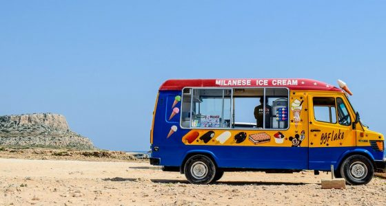 an ice cream truck on a beach