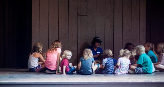 children listening to a young ranger at yosemite