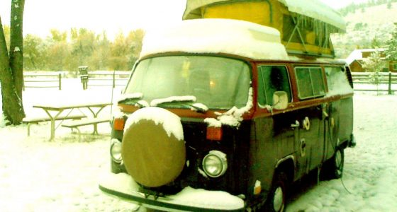 a 1978 vw bus covered in snow