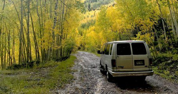 a van drives through the san juan mountains