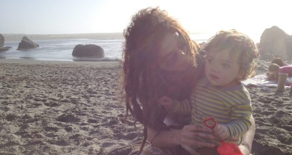 a mom and her baby boy on the Oregon Coast