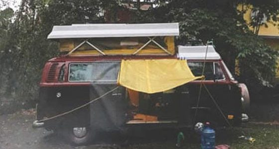 a VW Bus with a yellow awning