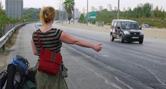 a woman hitchhiking in Europe