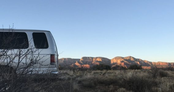 a van camping in a desert paradise