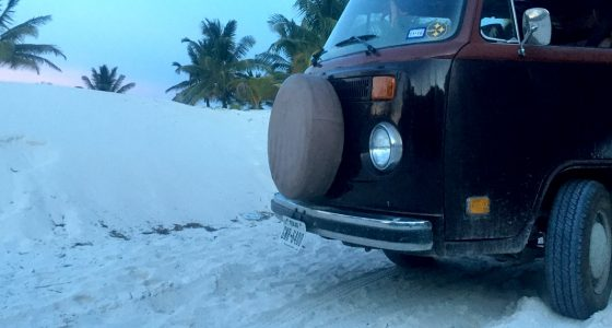 a volkswagen bus covered in white sand near Tulum, Quintana Roo, Mexico
