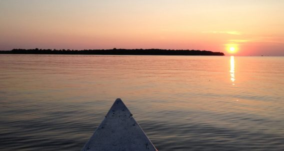 a canoe floats into the waters of Minnesota