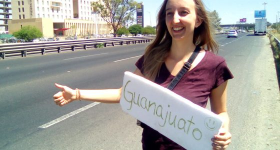 a german woman waiting for a ride as she hitchhikes across mexico