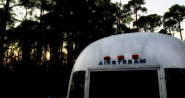 a vintage airstream travel trailer camping in Florida's forests