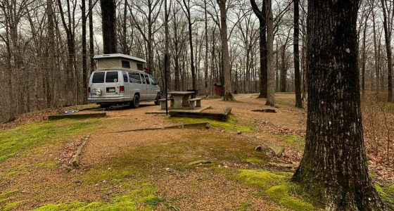 a sportsmobile van parked at a lush campground in Arkansas