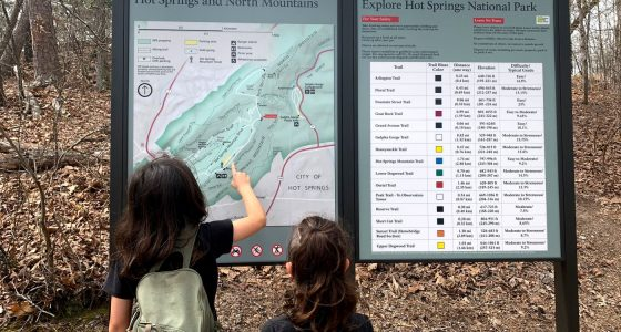 two boys study a map along hot springs arkansas' trails