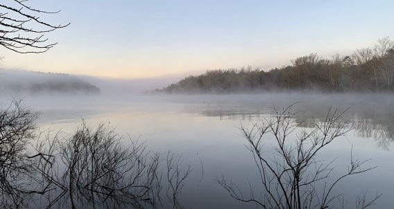 misty morning glory rises over a reservoir created by the Army Corp of Engineers