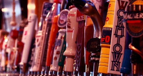 a line of beer taps