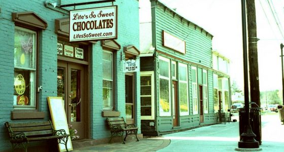 downtown Trumansburg, showing a chocolate shop on a cozy mainstreet