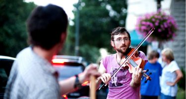 A busker playing the fiddle in the streets of Asheville