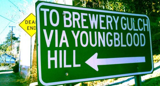 a sign reading To Brewery Gulch via Youngblood Hill, a Dead End sign in the background