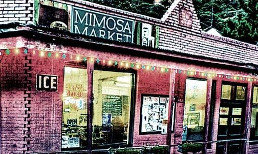 storefront of Mimosa Market, a small brick building nestled in the Mule Moutains, Bisbee AZ