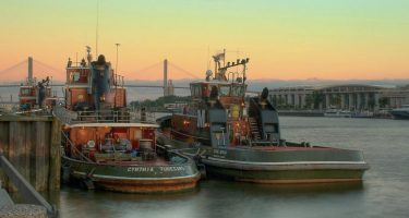 tugboats at sunrise in Savannah Georgia