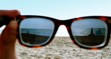view of the beach through a pair of sunglasses