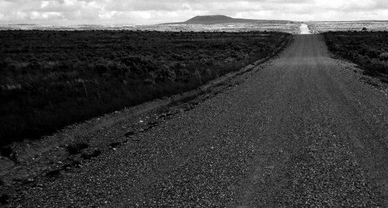 an endless, desolate dirt road through Idaho