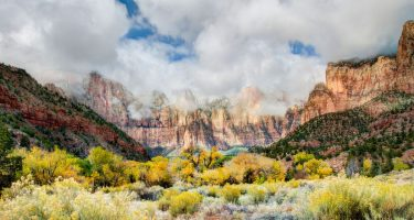 mist shrouds the tops of the peaks of Zion National Park