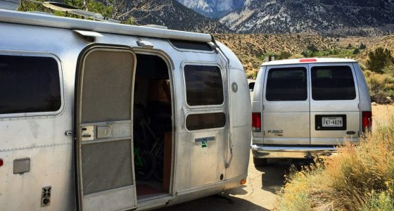 an Airstream and a silver van at Lone Pine Campground, Mt. Whitney in the background